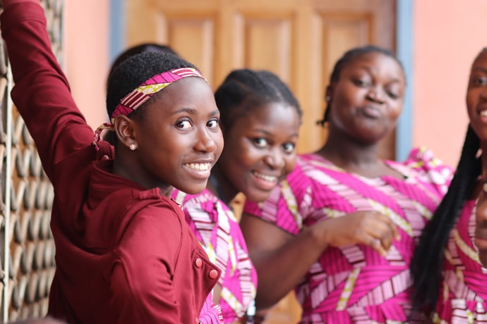 Members of the children's choir from Blessing United Methodist Church in Yaounde, Cameroon, welcome visitors to the Cameroon Mission Initiative meeting. From left are: Nahomie Diffo, Geneviève Nzie, Larissa Nzie and Falone Diffo. Photo by Isaac Broune, UM News.