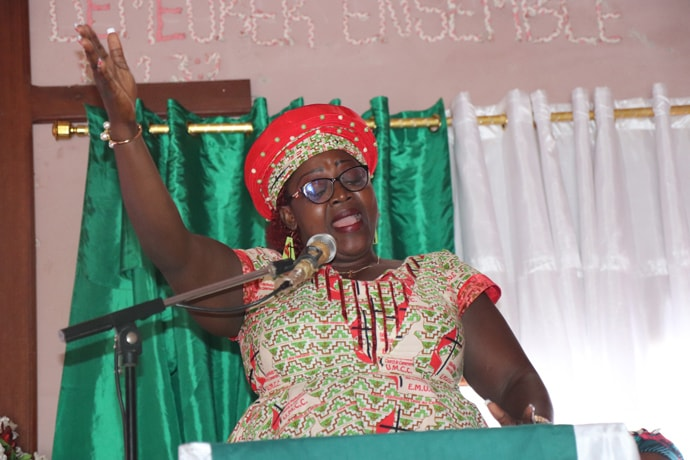 The Rev. Rosalie Nzie of Blessing United Methodist Church in Yaounde helps lead worship. Photo by Isaac Broune, UM News.