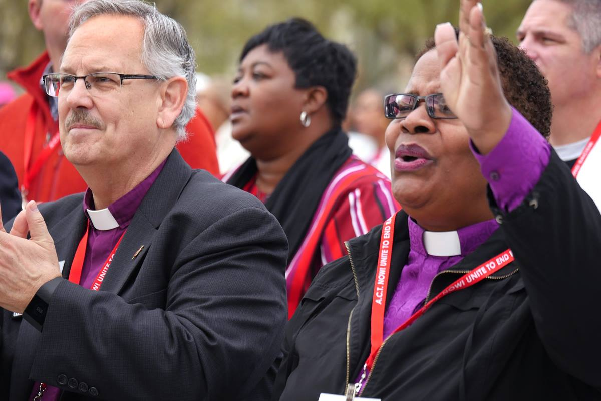 "United Methodist Bishops Bruce R. Ough and LaTrelle Easterling stand in solidarity during the national rally to end racism, a Drumbeat for Justice Silent Walk from the Martin Luther King Jr. Memorial to the National Mall on April 4, 2018. Bishop Easterling is among church leaders in Baltimore urging United Methodists to resist ""reactionary responses"" to President Donald Trump's tweets disparaging the city. File photo by Kathy L. Gilbert, UMNS."