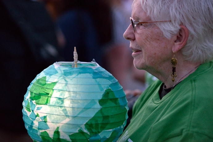 A participant holds a lantern during a climate vigil outside the 2016 United Methodist General Conference in Portland, Ore. The lanterns were lit with a small solar light and following the vigil were sent to community groups in the Philippines, the Democratic Republic of the Congo and the U.S. File photo by Paul Jeffrey, UM News.
