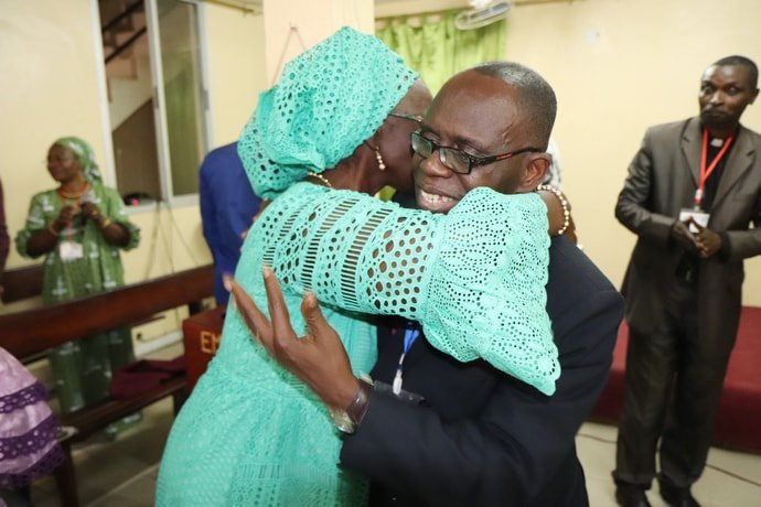 Côte d'Ivoire Area Bishop Benjamin Boni congratulates Ndeye Diouf on her retirement during the closing session of the annual assembly of West African United Methodist mission initiatives in Dakar, Senegal. Photo by Isaac Broune, UM News.