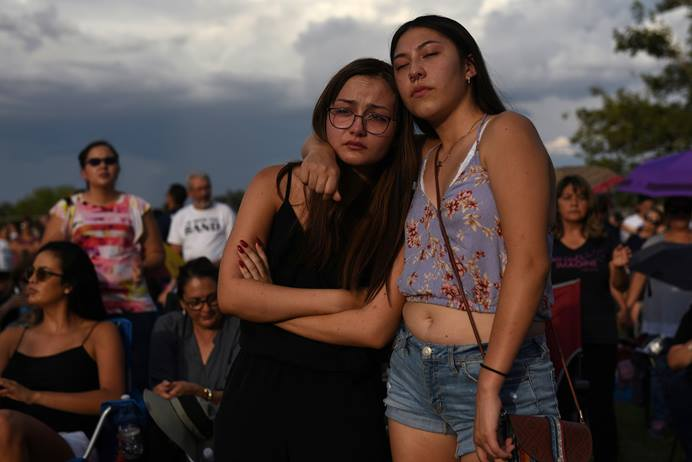 Amber Ruiz and Jazmyn Blake embrace during a vigil a day after a mass shooting at a Walmart store in El Paso, Texas, on Aug. 4. Photo by Callaghan O'Hare, Reuters.