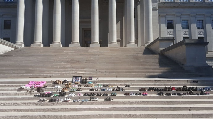 Shoes line the steps of the West Virginia State Capitol in Charleston during the annual Day of Overdose Awareness Tribute in 2016. The event was organized by the parents of Ryan Brown, who died from an overdose. Photo by Rick Bowles, Ryan's Hope.