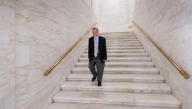The Rev. Jeff Allen walks through the West Virginia State Capitol in Charleston. Allen, executive director of the West Virginia Council of Churches, says it's important for the faith community to be heard in matters of public policy. Photo by Mike DuBose, UM News.