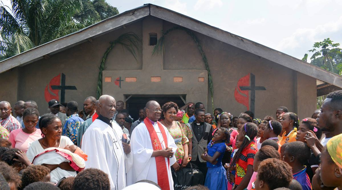 Bishop Gabriel Yemba Unda (center) helps rededicate the Yanda village United Methodist church, south of Kindu, Congo. Some 12 churches in the area have been renovated with more weatherproof materials with help from Martin (Tenn.) First United Methodist Church in the U.S. Photo by Chadrack Tambwe Londe, UM News.