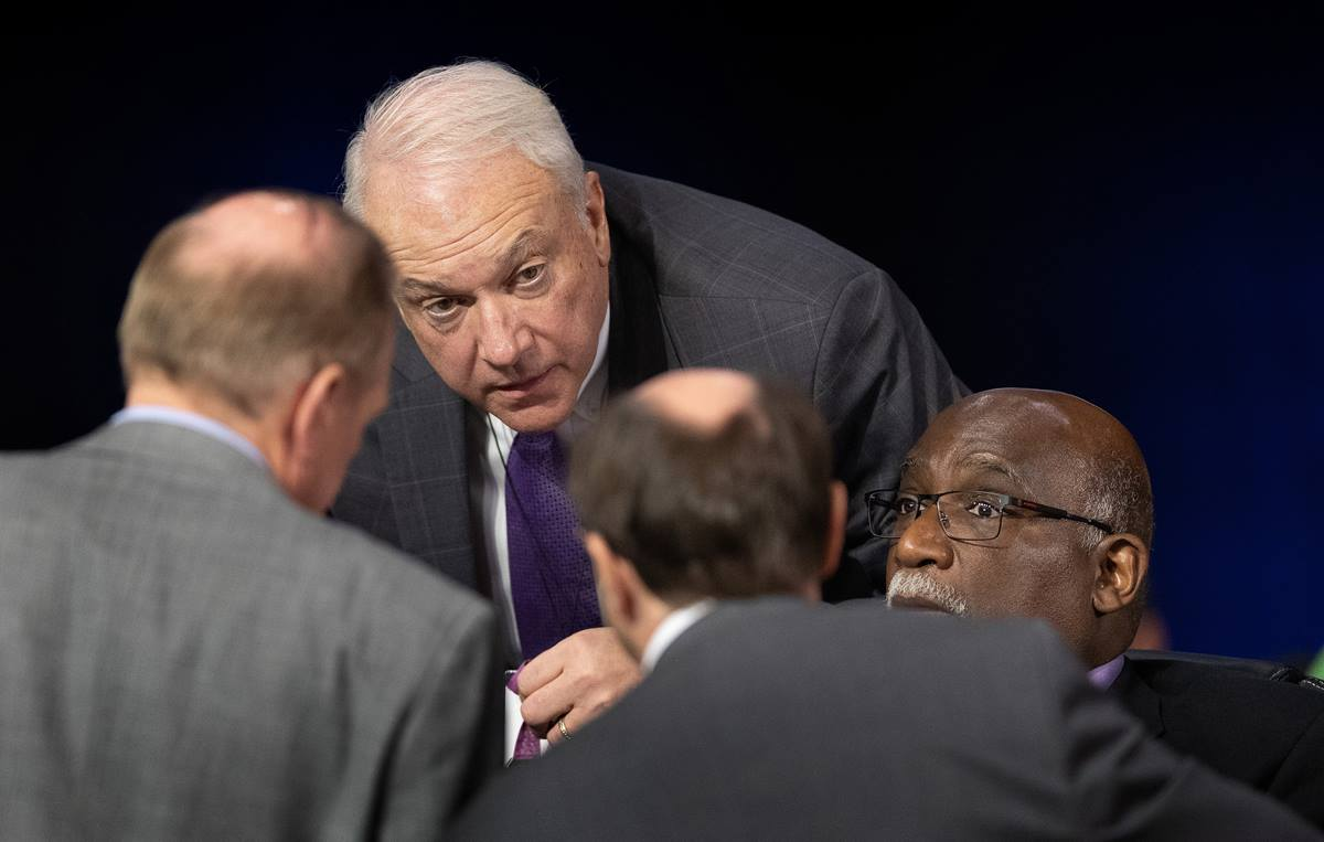 Bishops Thomas J. Bickerton (center) and Gregory V. Palmer (right) confer with colleagues on legislative procedures during the 2019 United Methodist General Conference in St. Louis. Bickerton is the Council of Bishops representative on the Commission on General Conference. The Commission on General Conference — meeting behind closed doors — reviewed an investigation that found evidence of four ineligible people casting votes using the credentials of delegates who were not present. File photo by Mike DuBose, UM News.