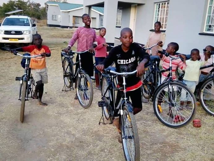 Children at the Nyadire Mission's Home of Hope orphanage in Mutoko, Zimbabwe, pose with new bikes provided by Dutilh United Methodist Church in Pittsburgh. Photo by Mary Beth Zollars.