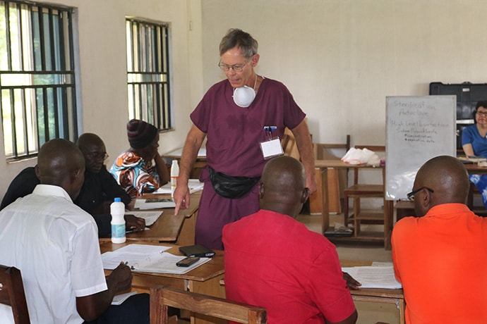 Dr. Bruce Cunningham (center) helps train community health workers to perform urgent-care dentistry during a workshop in Bambur, Nigeria. Cunningham is a board member for the Community Oral Health Initiative. Photo by Richard Fidelis, UM News.