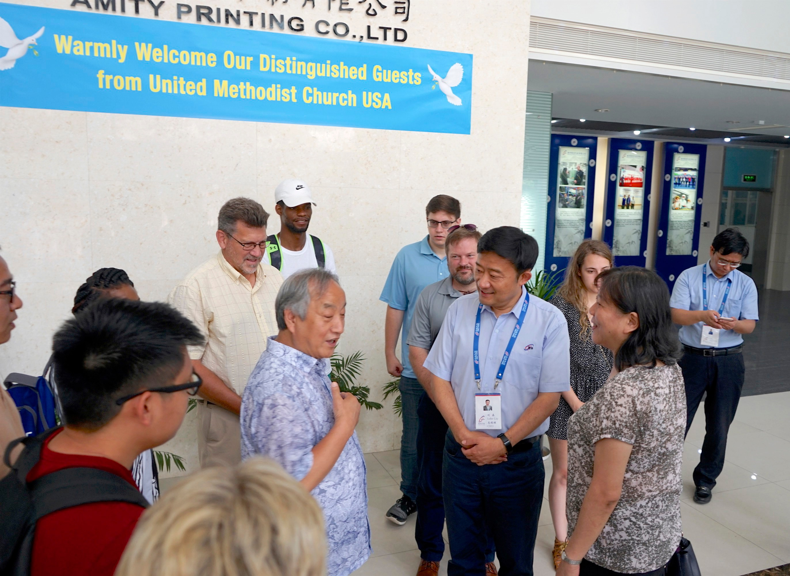 Wisconsin Area Bishop Hee-Soo Jung, center left, talks with officials from the Amity Printing Press in Nanjing, China, during a visit by a joint United Methodist Volunteers in Mission team from the denomination's North Central and Northeastern Jurisdictions. In November, Amity will print its 200 millionth Bible and Jung is among the Christian leaders invited to come and mark the occasion. Photo courtesy of the Rev. David Newhouse.