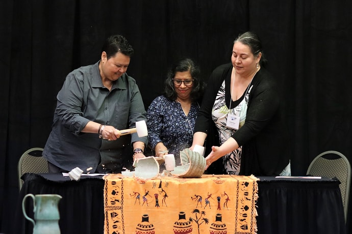 Members of MARCHA break a clay vessel as a symbol of the impact that decisions made by the 2019 General Conference have had on The United Methodist Church. From left are: the Revs. Vilma Cruz and Lucky Cotto and Pastor Imelda Roman. Photo by Michelle Maldonado, UMCOM.