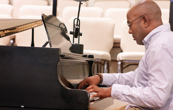 Raymond Trapp, the worship and music director at the 2020 General Conference, practices a hymn ahead of worship during the Commission on General Conference meeting in Lexington, Ky. Sessions of the 2020 General Conference will begin with worship every day. Photo by Heather Hahn, UM News.