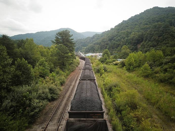 A train loaded with coal sits on the tracks inside the now-bankrupt mining company Blackjewel's former Black Mountain mining complex. United Methodist churches have stepped up to offer food, school supplies and help with utility bills to out-of-work miners. Photo by Charles Mostoller/Reuters photo