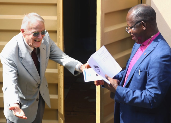Dr. Lowell Gess (left) ushers Sierra Leone Area Bishop John Yambasu into the new surgical theater of the Lowell and Ruth Gess United Methodist Eye Hospital in Freetown, Sierra Leone, after a dedication ceremony in front of the building. Gess started the eye clinic at Kissy, rural Freetown at the time, creating a new level of eye care for West Africa. Photo by Phileas Jusu, UM News.