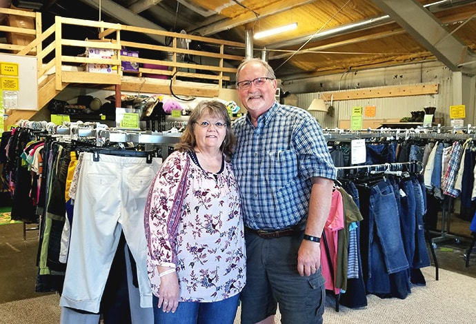 Kathy and the Rev. Jim Konsor at the Bakken Oil Ministry thrift shop in Watford City, N.D. The couple retired from the ministry July 1. Both were named as winners of the Harry Denman Evangelism Award in 2019. Photo courtesy the Bakken Oil Rush Ministry.