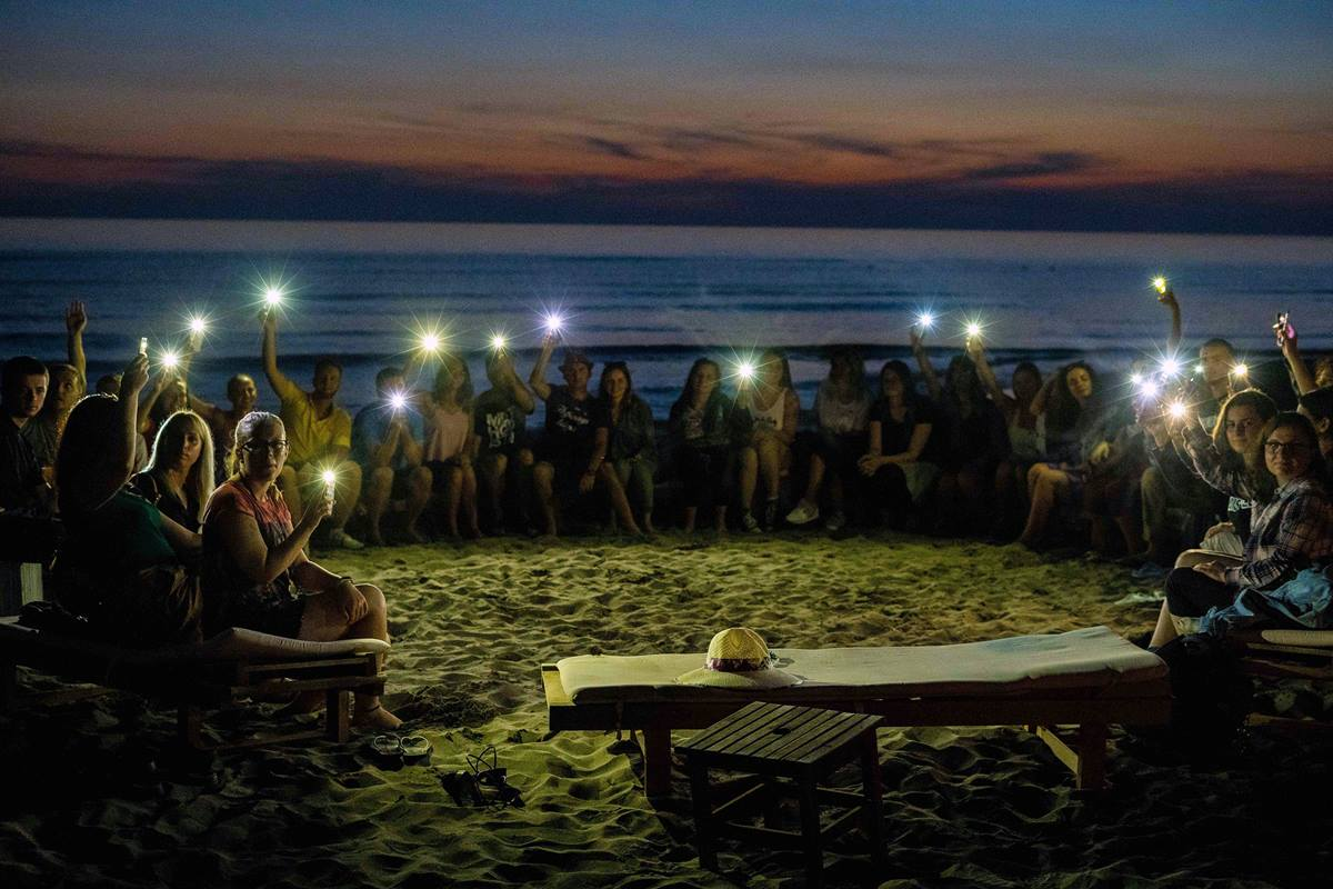 "About 30 young people from Albania, Macedonia and Serbia gathered for the second United Methodist Regional Youth Camp in the coastal area of Spille, Albania. A sunset visit to the beach turned into an impromptu worship service for as those in attendance gathered in a circle and ""praised the Lord."" Photo by Danail Ristovski, Skopje/Macedonia."