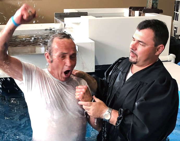 The Rev. Casey Turner baptizes a man trying to overcome addiction at the Breaking Bonds Ministries campus in Jonesboro, Arkansas. Photo courtesy of Breaking Bonds Ministries.