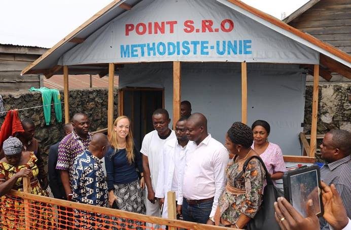 Megan Klingler, with the United Methodist Board of Global Ministries' Global Health unit, visits a health checkpoint set up to treat cholera patients outside Majengo Health Center, a United Methodist hospital in Goma, Congo. Photo By Philippe Kituka Lolonga, UM News.