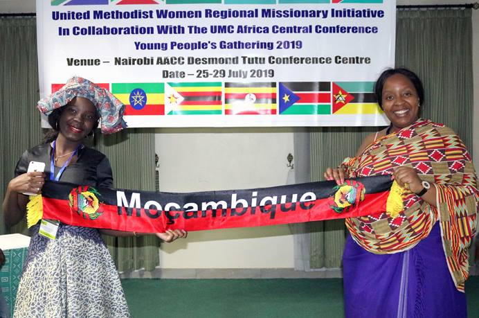 """Two young women from Mozambique showcase their traditional attire during the Africa Youth and Young Adult Network gathering in Nairobi, Kenya. Young United Methodists from across the African continent gathered at the Desmond Tutu Conference Centre under the theme """"Arise and Shine."""" Photo by Gad Maiga, UM News."""