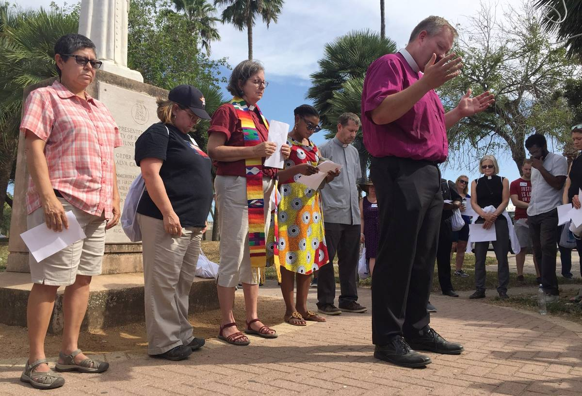 An ecumenical group from Texas holds a prayer vigil at the Texas-Mexico border. United Methodists made up a large part of a group of more than 100 who spent part of the Labor Day Weekend at the border and crossed into Matamoros, Mexico, to visit with Central Americans and others who are being kept there as they seek asylum in the U.S. Photo courtesy of Texas Impact.
