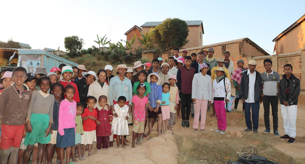 Members of a new United Methodist church community gather in Antsiazopaniry, some 50 kilometers from Antananarivo, the capital of Madagascar. Though only officially a church for a year, United Methodism is taking hold in the island nation. Photo by João Filimone Sambo, UM News.