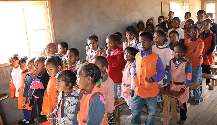 Students stand to recognize a visitor at the Alpha Primary School, located in a poor urban area of Antananarivo, Madagascar. The school serves as a gathering place for one of two new United Methodist communities in the country.  Photo by João Filimone Sambo, UM News.