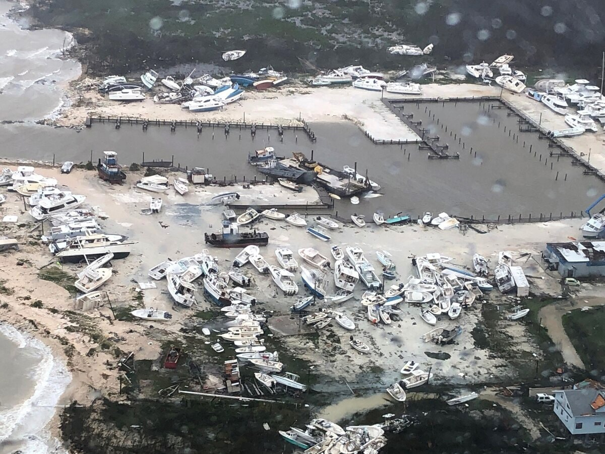 An aerial view shows damage to a marina after Hurricane Dorian pummeled the Bahamas for several days beginning Sept.1. The Coast Guard supported the Bahamian National Emergency Management Agency and the Royal Bahamian Defense Force, who led search and rescue efforts in the Bahamas. Photo by Hunter Medley, U.S. Coast Guard, courtesy of Coast Guard Air Station Clearwater.
