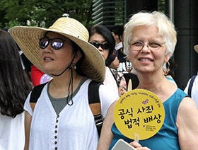 The Revs. HiRho Park and Kathryn Armistead were among those attending the seventh memorial day for comfort women in Seoul. Comfort women were women and girls who were forced into sexual slavery by the Japanese Army during World War II. Photo by the Rev. Thomas Kim, UM News.
