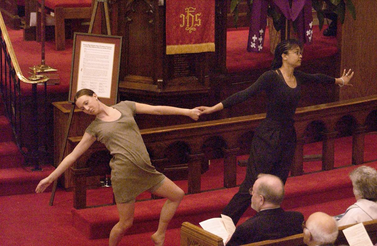 Kimberly Pitcher-Crago (left) and Ellen Hawes present a liturgical dance during a 2002 service of repentance by Foundry United Methodist Church at Asbury United Methodist Church in Washington. In the 19th century, racial discrimination at Foundry led to the formation of Asbury and later John Wesley AME Zion. File photo © Jay Mallin.