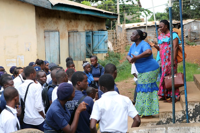 United Methodist Women of the Sierra Leone Conference urge students at Lorenzo Gorvie Memorial Secondary School in Waterloo, Sierra Leone, not to cheat on exams.  The women are taking their anti-cheating campaign to United Methodist schools across the country. Photo by Phileas Jusu, UM News.