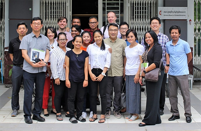 Members of the Cambodia Human Trafficking Consultation Mission team gather in front of the United Methodist Board of Global Ministries office in Phnom Penh. The team included six Korean American United Methodists and seven staff members from Global Ministries. Photo by the Rev. Thomas Kim, UM News.