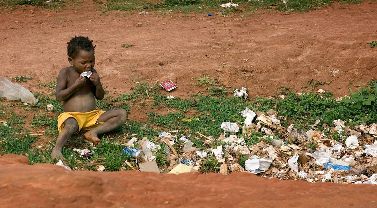 A child scavenges for food in a garbage pit just outside the Hope for the Children of Africa School near Malanje, Angola, in 2006. The school was named for the United Methodist Council of Bishops' appeal that provided funds for its construction. World hunger can be wiped out by 2030 according to the Bread for the World Institute. File photo by Mike DuBose, UM News.