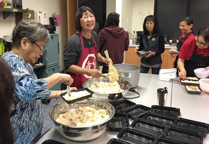 """Volunteers pack meals for the Blessed Bento program at Faith United Methodist Church in Torrance, Calif. The Rev. Allison Mark describes the program as the church's """"healthy Japanese meals on wheels"""" program. Photo courtesy of Faith United Methodist Church."""