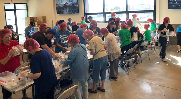 Volunteers at Faith United Methodist Church in Torrance, Calif., in partnership with the Rise Against Hunger organization. Photo courtesy of Faith United Methodist Church.