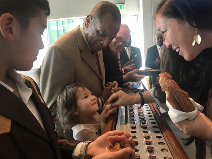 The Rev. Allison Mark (right), senior pastor at Faith United Methodist Church in Torrance, Calif., serves communion to a young girl. Photo courtesy of Faith United Methodist Church.