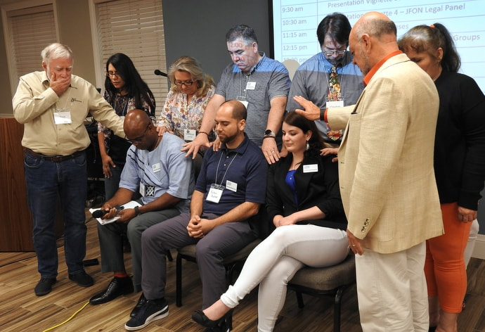 Prayers are offered for lawyers of San Antonion Region Justice For Our Neighbors, a United Methodist immigration ministry, during the Border Convocation in San Antonio. The Rio Texas Conference event, held Sept. 20-21, drew about 115 people for discussion of how immigration ministries can respond better as the U.S. restricts entry of asylum seekers. Photo by Sam Hodges, UM News.