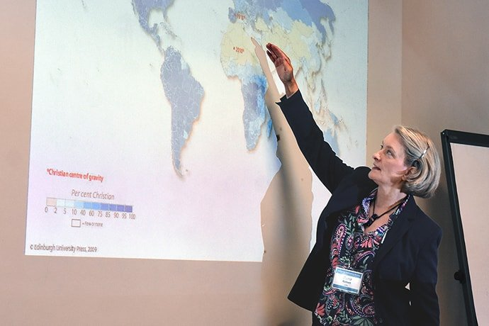 Dana Robert points to a global map featuring percentages of Christians worldwide during a session to provide training for leaders of churches impacted by migration. The United Methodist Board of Global Ministries sponsored the event Aug. 22-30 at The United Methodist Church of Germany Educational and Training Center in Stuttgart, Germany. Photo by Üllas Tankler, Board of Global Ministries.