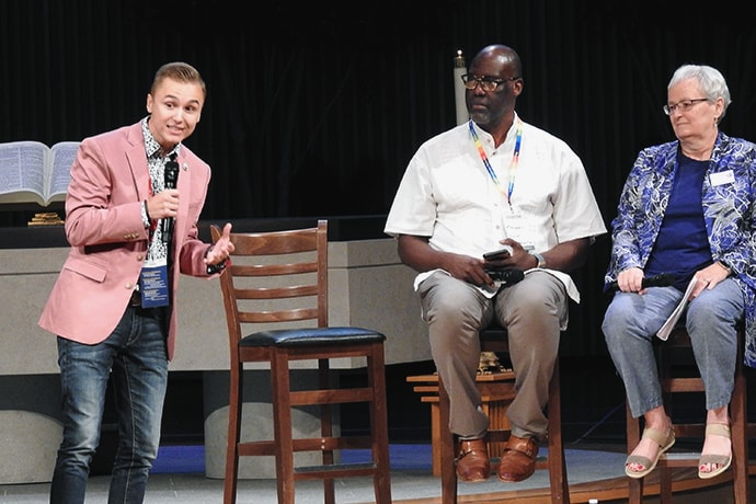 J.J. Warren speaks at the Sept. 25-27 Leadership Institute, held at the United Methodist Church of the Resurrection in Leawood, Kansas. Warren is an openly gay man who spoke at General Conference 2019 of his evangelism work LGBTQ college students. Joining him for a panel on LGBTQ inclusion in The United Methodist Church were Randall Miller and Jan Lawrence of Reconciling Ministries Network. Photo by Sam Hodges, UM News.