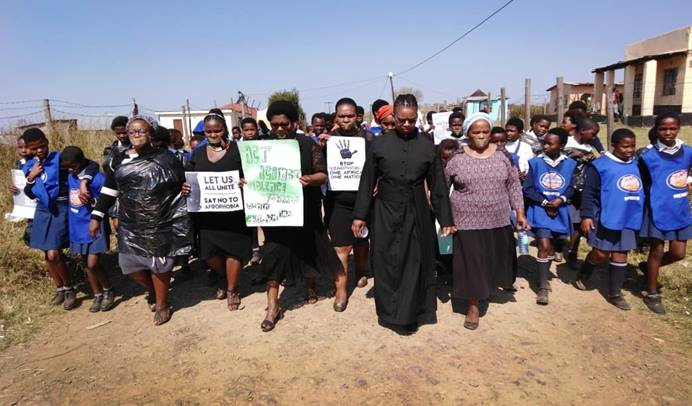 United Methodist deaconess Bulelwa Ndedwa leads a march against gender-based violence in Durban, South Africa, on Sept. 14.  The march began with prayer at a United Methodist church and ended in downtown Bizana in the Makukhanye District, Eastern Cape. Photo by Nandipha Mkwalo, UM News.