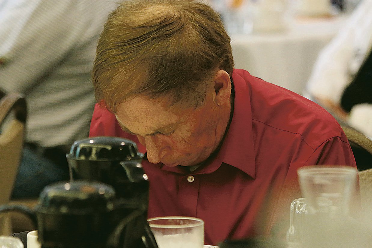 Dennis Valstad pauses in prayer during an event at Immanuel United Methodist Church. Photo courtesy of Ripon Commonwealth Press-Express.