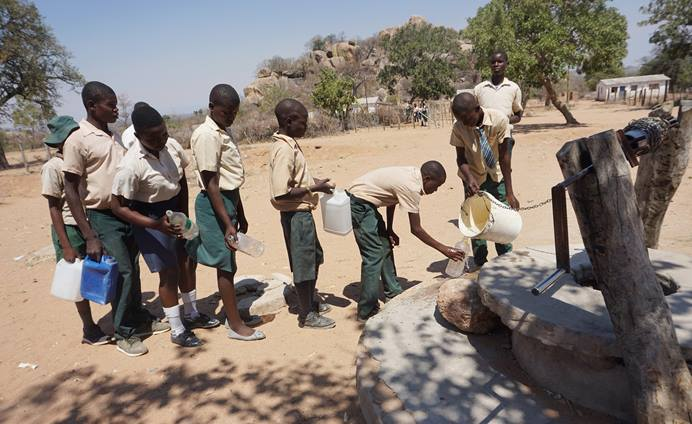 Water is scarce at Chapanduka Secondary School, a United Methodist school in Buhera, Zimbabwe. Students often spend learning time standing in line to fill buckets of water from a shallow well. Photo by Kudzai Chingwe, UM News.