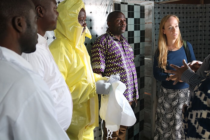 Megan Klingler hears how Majengo Health Center in Goma, Congo, isolates suspected Ebola cases that arrive at the United Methodist hospital. There have been more than 3,000 confirmed cases of Ebola since the outbreak was declared Aug. 1, 2018. Photo by  Philippe Kituka Lolonga, UM News.
