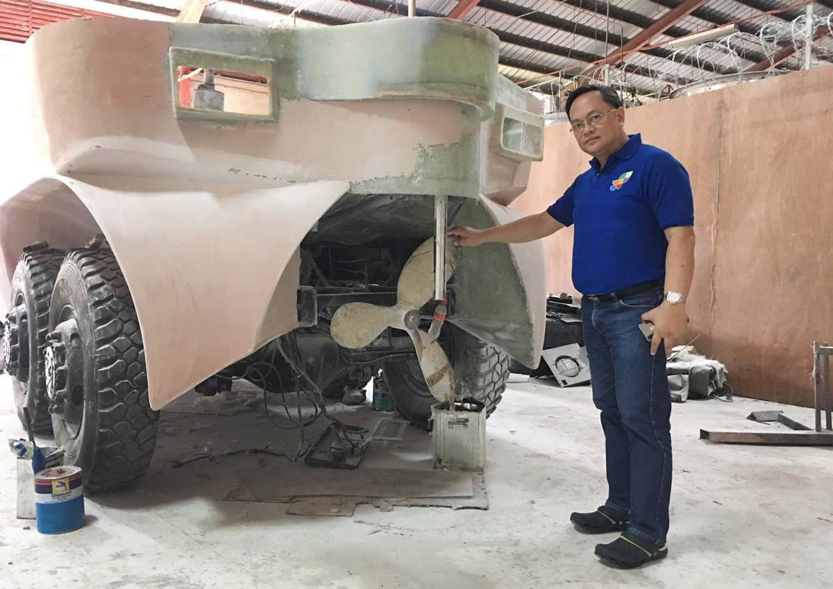 Julius Caesar V. Sicat, regional director of the Philippine Department of Science and Technology, stands by an amphibious rescue vehicle prototype designed to save lives in the event of major flooding. Photo courtesy of Ryan de Lara.