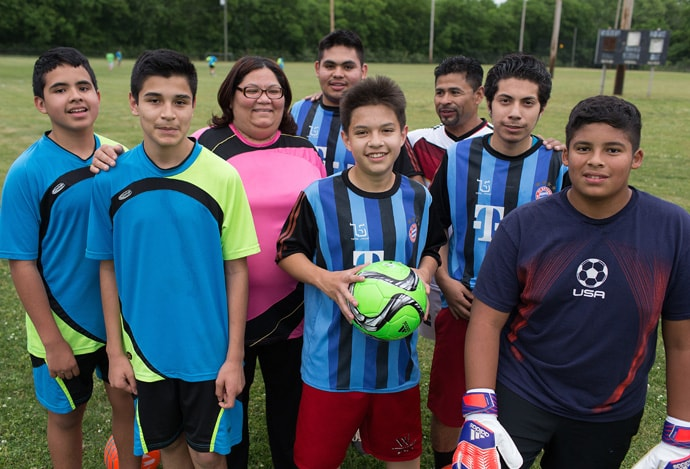 The Rev. Myriam Cortes (third from left) is director of the Ministerio Metodista Ebenezer and a licensed local pastor in The United Methodist Church. The ministry, which is affiliated with 61st Ave. United Methodist Church in Nashville, offers a soccer program for Latino youth. Photo by Mike DuBose, UMNS.