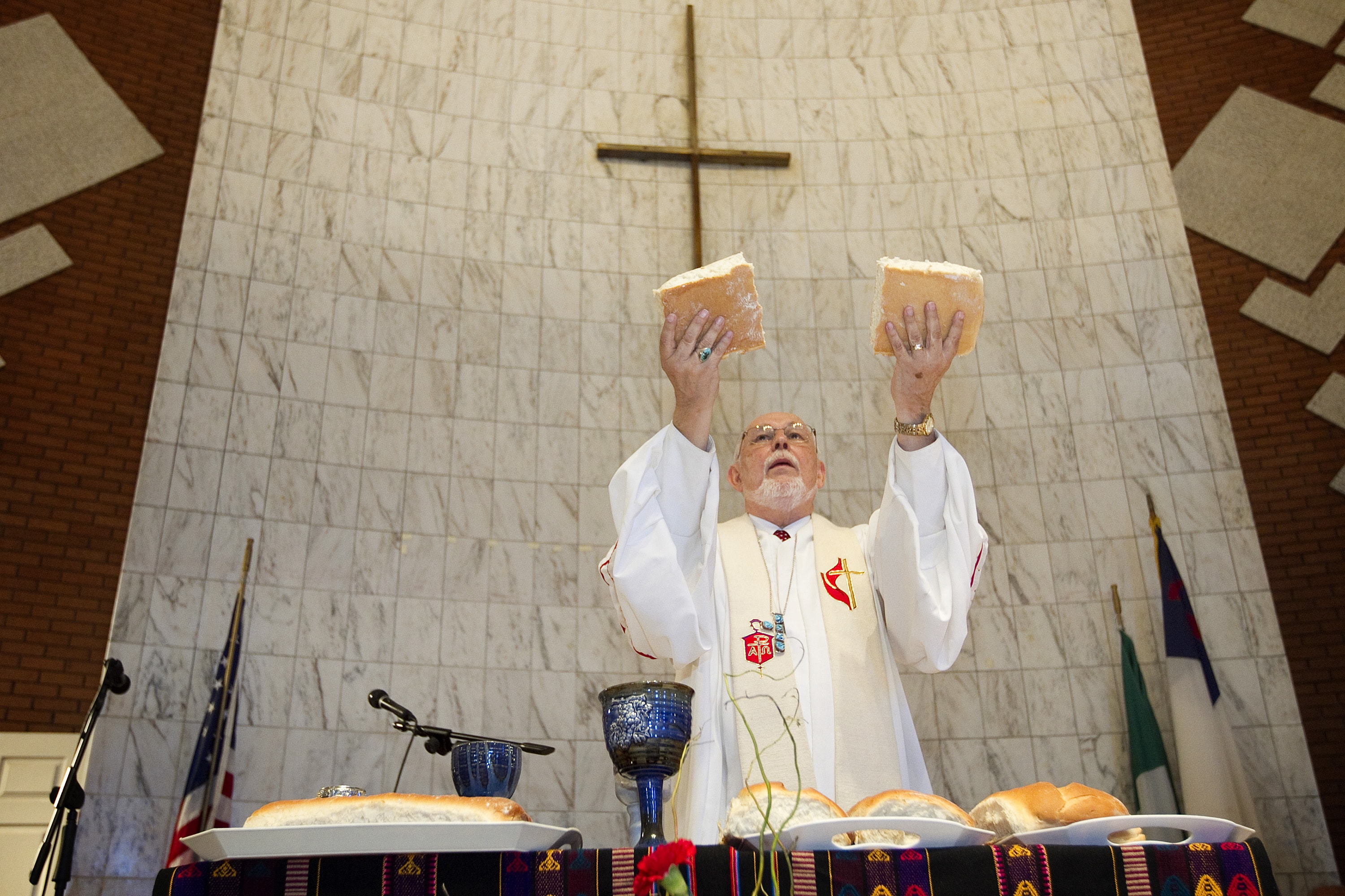 Bishop Joel N. Martinez blesses the elements of Holy Communion during opening worship at the 2011 MARCHA meeting at the Lydia Patterson Institute in El Paso, Texas. File photo by Mike DuBose, UMNS.