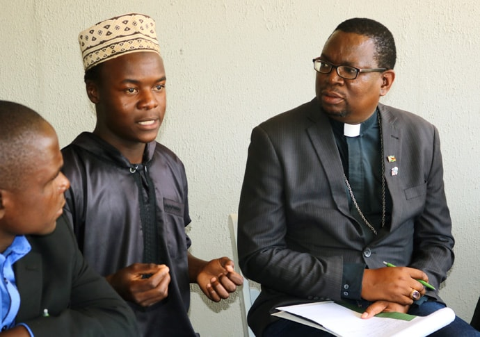 A youth member of the Islamic community and Bishop Eric Ruwona of the Anglican Diocese of Manicaland participate in interfaith dialogue calling for men and boys' involvement in the fight against HIV in Zimbabwe. Photo by the Rev. Taurai Emmanuel Maforo, UM News.