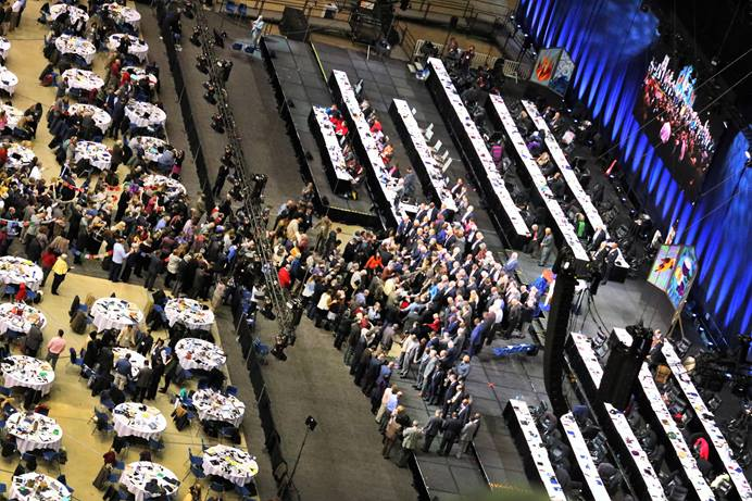 Delegates and bishops join in prayer at the front of the stage before a key vote on church policies about homosexuality during the 2019 United Methodist General Conference in St. Louis. The docket of the Oct. 29-Nov. 1 Judicial Council meeting in Evanston, Illinois, includes items related to decisions made by the denomination in St. Louis. File photo by Thomas Kim, UM News.
