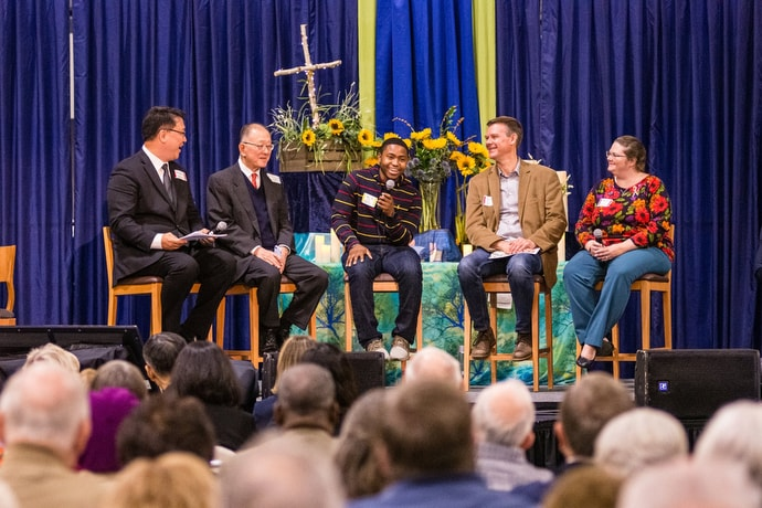Zach Holder (center) tells the conference how the Way Forward team agreed on recommendations that encourage congregations to develop covenants to be in ministry that are authentic to who they are called to be. Joining Holder, from left: the Rev. Sang Won Doh, Michael Hoon Yan and the Rev. Tom Korkuch and the Rev. Amanda Hemenetz. Photo by Corbin Payne.