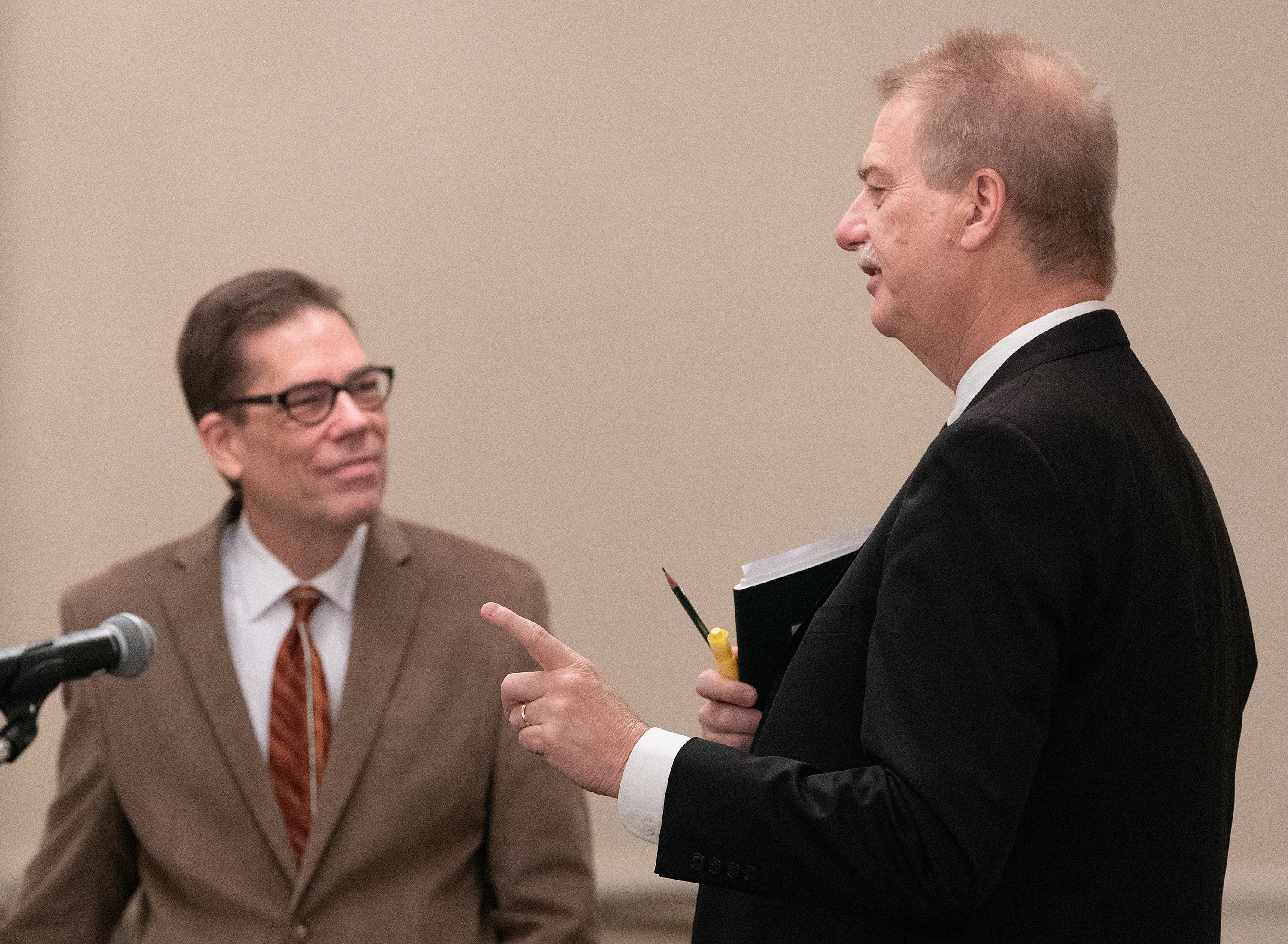 The Rev. Tom Lambrecht (left) and Bishop Kenneth H. Carter visit prior to the start of oral hearings before the United Methodist Judicial Council meeting in Evanston, Ill. Lambrecht is vice president and general manager of Good News and a member of the Wesleyan Covenant Association leadership. Carter is president of the denomination's Council of Bishops. Photo by Mike DuBose, UM News.