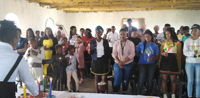Deaconess Bulelwa Ndedwa, South Africa Conference youth director, educates girls and women in Notazana Village in Eastern Cape about the importance of proper hygiene during their menstrual cycles. Photo by Nandipha Mkwalo, UM News.