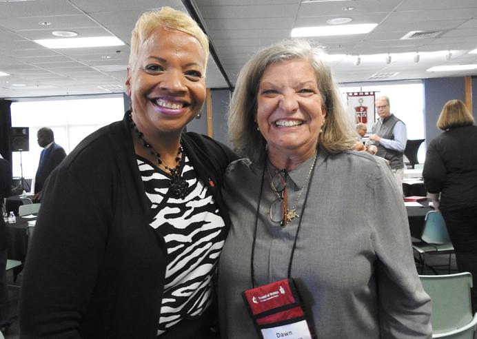 "United Methodist Bishop Tracy Smith Malone (left) and Dawn Wiggins Hare celebrate an amendment to the denomination's constitution that proclaims ""men and women are of equal value in the eyes of God."" Ratification of the amendment was announced during the United Methodist Council of Bishops meeting in Lake Junaluska, N.C. Photo by Sam Hodges, UM News."